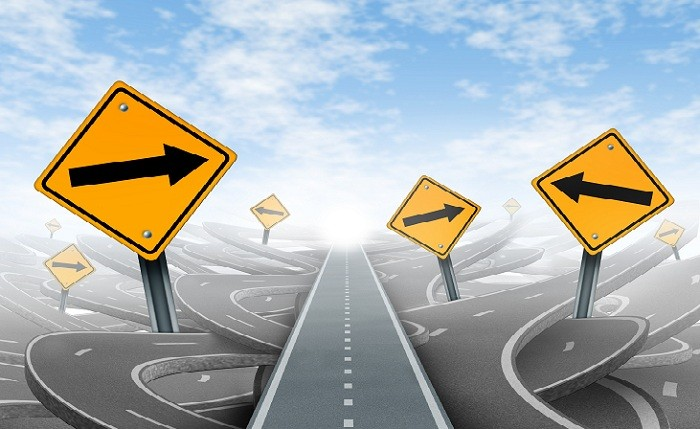 Clear strategy and solutions for business leadership symbol with a straight path to success as a journey choosing the right strategic path for business with blank yellow traffic signs cutting through a maze of tangled roads and highways.